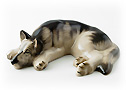 This black and tan porcelain German Shepherd figurine is taking a snooze.
