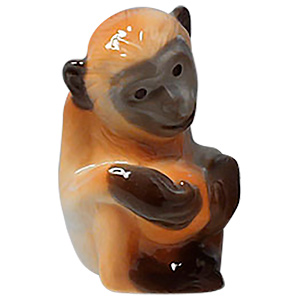 Monkey With Ball Figurine