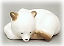 Why isn't this little polar Bear Cub figurine in white bear school? Because he is sweetly sleeping the afternoon away.
