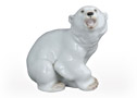 You don't have to know much about Polar Bears to give this young polar bear figurine some respect.